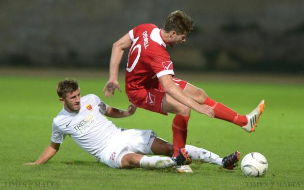 Valletta's Llywelyn Cremona slides in, trying to steal the ball from Newtown's Jason Oswell, during their Europa League match against Newtown at Hibs Stadium in Paola on July 9. Photo: Matthew Mirabelli