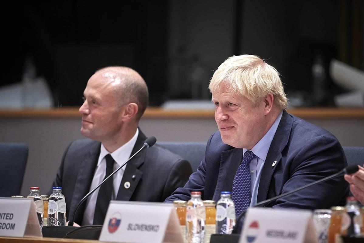 Prime Minister Joseph Muscat sits near UK counterpart Boris Johnson at Thursday's EU summit