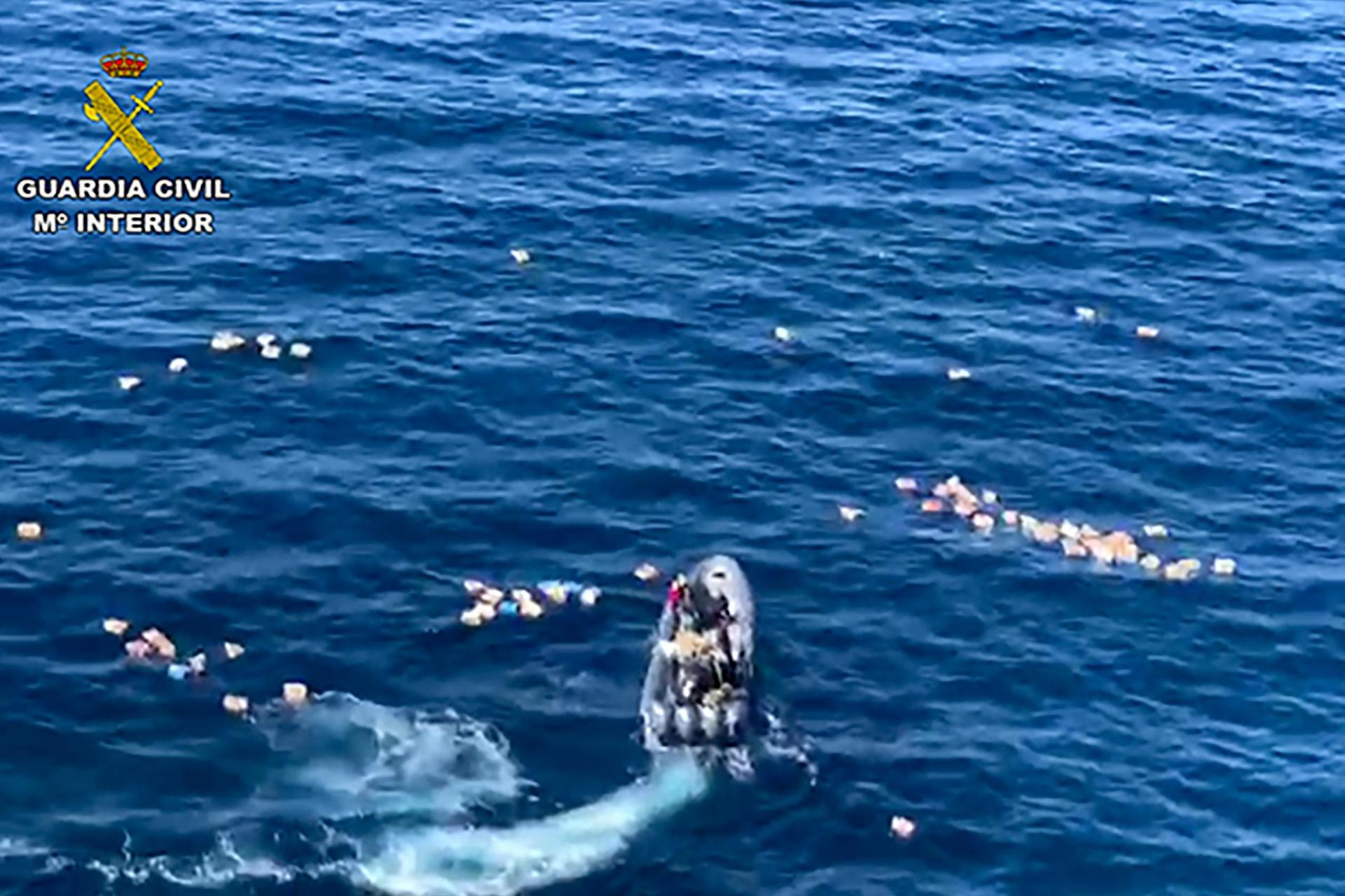 Spanish police saved from sea by smugglers they were chasing