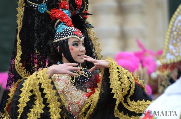 A girl performs on stage at the Children's Carnival in St George's Square, Valletta on February 17, a week later than planned due to bad weather. Photo: Matthew Mirabelli