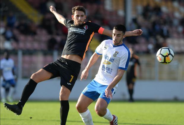 Triston Caruana (left) of Ħamrun Spartans tussles with Pietá Hotspurs' Neil Pace Cocks for the ball. Photo: Matthew Mirabelli