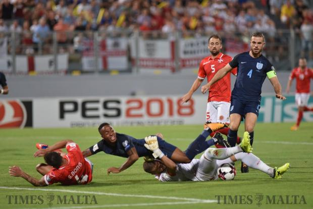 Malta Goalkeeper Andrew Hogg stops England Forward during a Fifa World cup Qualifier held at Ta' Qali Stadium on September 01. Photo Mark Zammit Cordina