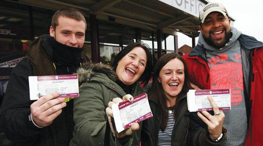 Take That fans showing off their tickets for the band's concert outside Villa Park, Birmingham, yesterday. Photo: David Jones/PA Wire