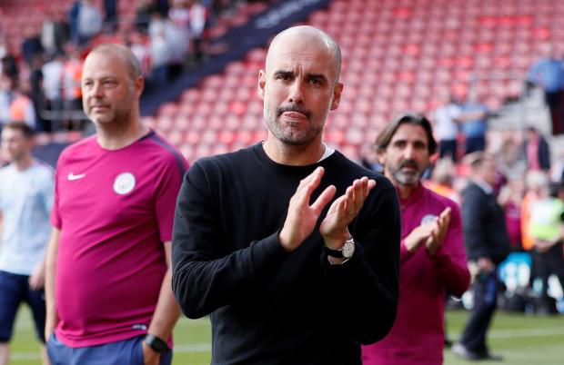 Manchester City manager Pep Guardiola applauds fans after the match.