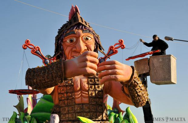 A man carries out some finishing touches on a carnival float in Valetta on February 5 Photo: Chris Sant Fournier