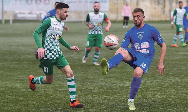 Gudja midfielder Llywelyn Cremona (right) controls the ball during the match against Qrendi at the Tedesco Stadium last weekend. Photo: Mark Zammit Cordina