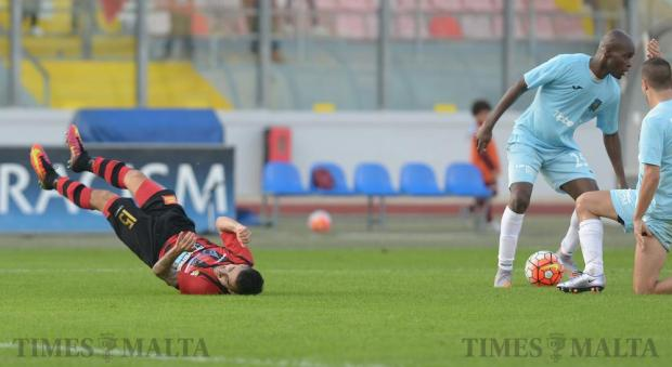 Hamrun Spartans' Luke Sciberras falls to the ground after being tackled by Gzira United's Souleymane Dianoutene during their BOV Premier League match at the National Stadium in Ta'Qali on November 26. Photo: Matthew Mirabelli