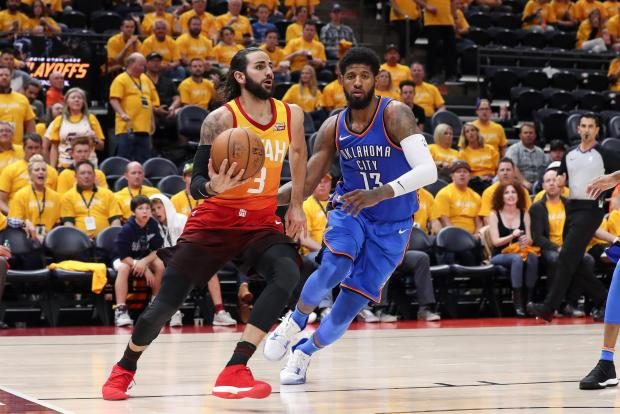 Utah Jazz guard Ricky Rubio (3) looks to pass the ball against Oklahoma City Thunder forward Paul George (13) during the third quarter in game three of the first round of the 2018 NBA Playoffs at Vivint Smart Home Arena. Utah won 115-102. Photo Credit: Chris Nicoll-USA TODAY Sports