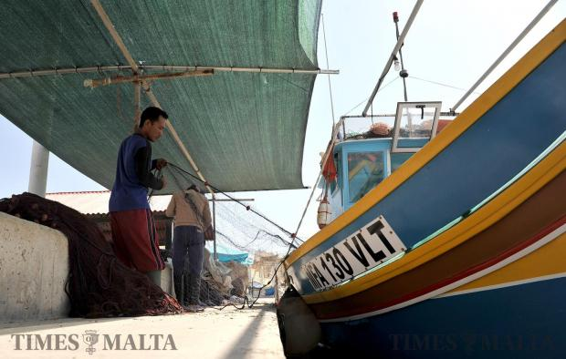 Fishermen prepare their nets ahead of the Lampuki season in Marsaxlokk on August 10. Photo: Chris Sant Fournier