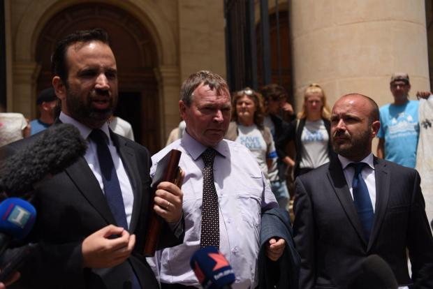 The captain with his legal team outside court. Photo: Mark Zammit Cordina