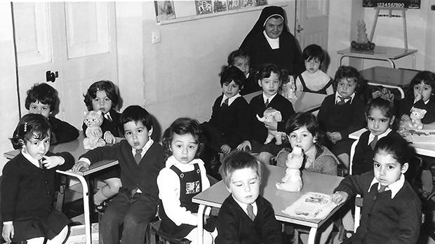 Sr Connie Farrugia teaching the infants at St Joan Antide School, Gudja, in the late 1970s.