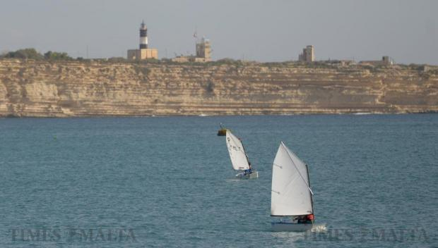 Two sailing dinghies enjoy the calm waters of Birzebbugia Bay on January 9. Photo: Matthew Mirabelli