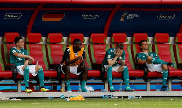Germany's Mesut Ozil, Antonio Rudiger, Marco Reus and Thomas Muller look dejected after the match as they go out of the World Cup.