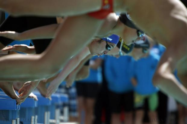 Swimmers dive into the pool at the start of a race during the 2015 Easter International Swim Meet at the National Pool in Tal-Qroqq on April 11. Photo: Darrin Zammit Lupi