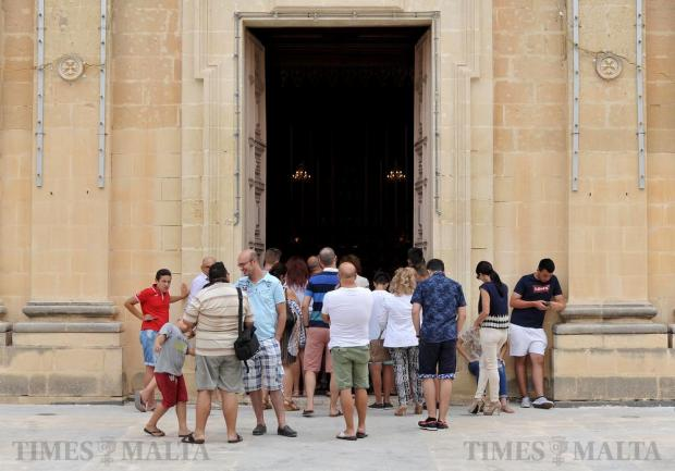 Church-goers listen to Mass on the feast of Santa Marija in Mqabba on August 15. Photo: Chris Sant Fournier