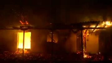 Watch: Wildfire kills at least 60 near Athens, families embrace as flames close in