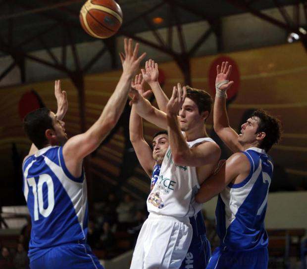 Floriana's Mark Henniger (2nd right) passes the ball through the Athleta defence during their basketball league match at the Ta' Qali Pavilion on January 25. Photo: Darrin Zammit Lupi