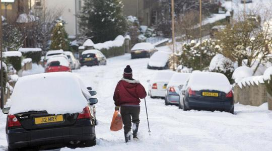 Plodding through heavy snow in Edinburgh as the cold snap hitting the UK continues. Photo: David Cheskin/PA Wire