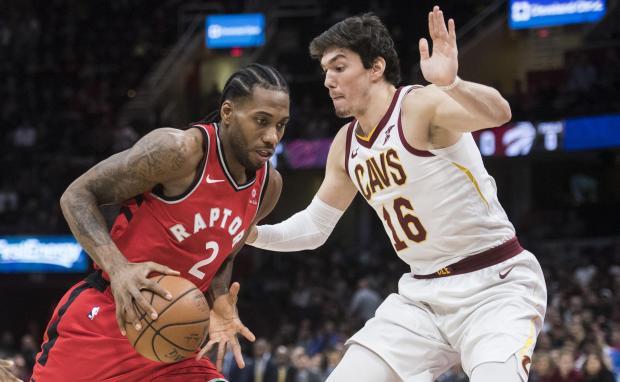 Toronto Raptors forward Kawhi Leonard (2) drives to the basket against Cleveland Cavaliers forward Cedi Osman (16) at Quicken Loans Arena. Mandatory Credit: Ken Blaze-USA TODAY Sports
