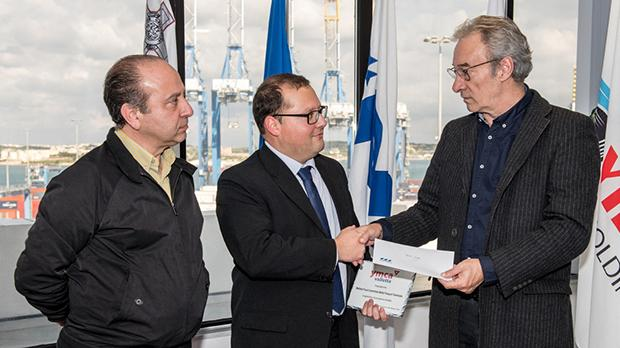 From left: Freeport welfare committee member and chairman Tonio Azzopardi and Jurgen Darmanin with YMCA events and fundraising officer Julian Holland.