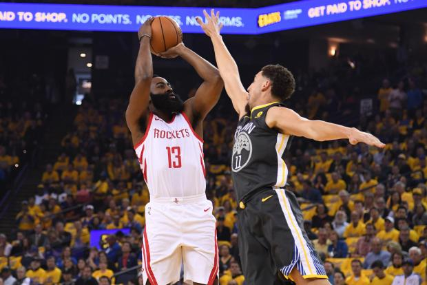 Houston Rockets guard James Harden (13) shoots against Golden State Warriors guard Klay Thompson (11) during the first quarter in game four of the Western conference finals of the 2018 NBA Playoffs at Oracle Arena. Photo Credit: Kyle Terada-USA TODAY Sports