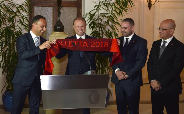 Prime Minister Joseph Muscat is presented with a Valletta 2018 scarf as a gift from the V18 Chairman Jason Micallef on January 16. Photo: Mark Zammit Cordina