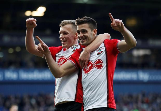 Southampton's Dusan Tadic celebrates scoring their second goal with James Ward-Prowse.