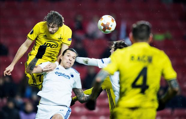 Yuri Kendysh of FC Sheriff and Federico Santander of FC Copenhagen in action.