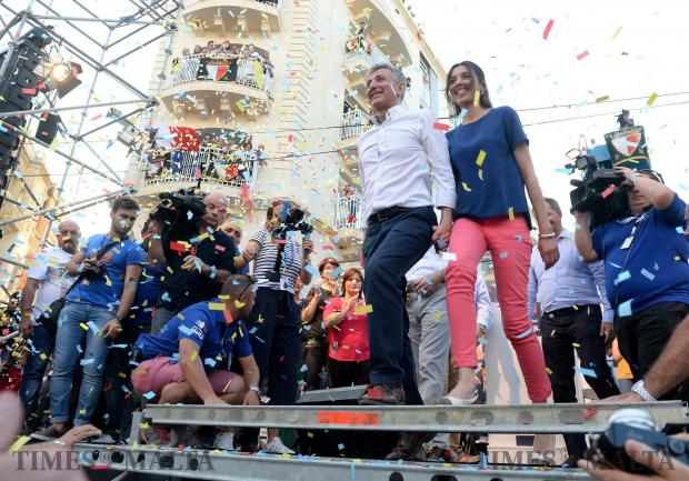 Simon Busuttil accompanied by his partner Kristina make their way into the crowd during a mass meeting in Sliema on May 28. Photo: Matthew Mirabelli