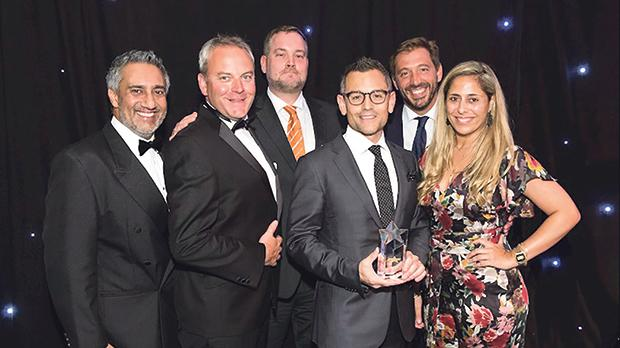 EC executive chairman Andrew Mangion (fourth from left) after receiving the award, accompanied by (from left) marketing director Ricky Sharma, young learners director Charlie Tweddle, regional sales director – MENART Robin Garforth, global sales director Fernando Aguilar and regional sales director – Europe Katya Bonello.