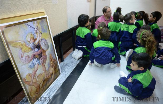 A primary school student stares at a painting of St Michael during an activity at the Mdina Cathedral Museum in Mdina on March 20. Photo: Matthew Mirabelli