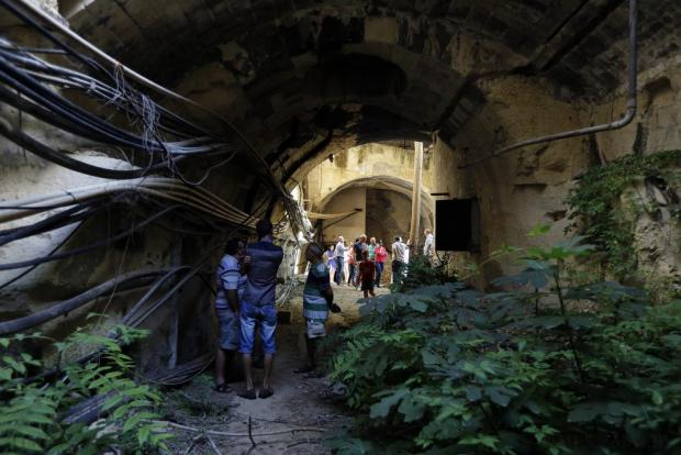 Visitors walk through a tunnel forming part of the old Malta Railway which was closed down in 1931 in Floriana, on October 18. Locals and tourists flocked to see part of the network of tunnels which were opened to the public as part of the annual Genna ta' Gonna event. The 900-metre-long railway tunnel runs below Floriana, from City Gate to Porte des Bombes. Photo: Darrin Zammit Lupi