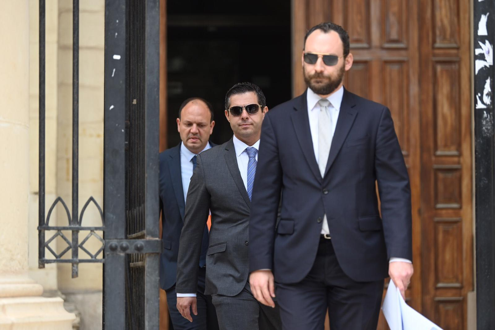 Architect Roderick Camilleri, left, leaves court with lawyers Alfred Abela and Arthur Azzopardi. Photo: Mark Zammit Cordina