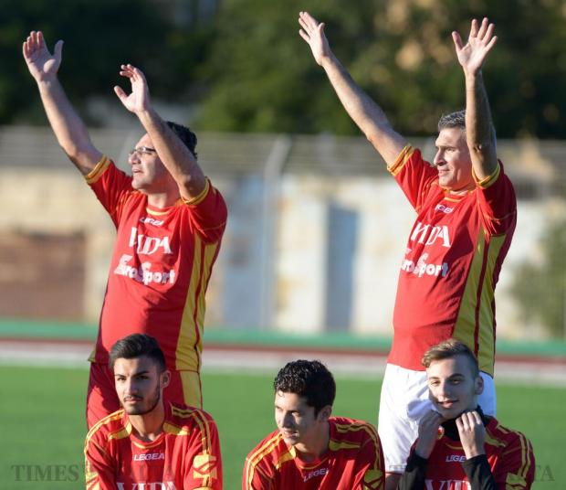 Nationalist's Party MP David Agius (left) and Minister for Home Affairs and National Security Carmelo Abela (right) call over their team mates for a group photo before a charity football match at St Aloysius College in Birkirkara on 29 December. Photo: Matthew Mirabelli