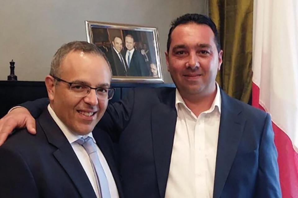 Self-confessed murder middleman Melvin Theuma (right) posing with former OPM chief of staff Keith Schembri during their April 2017 meeting.