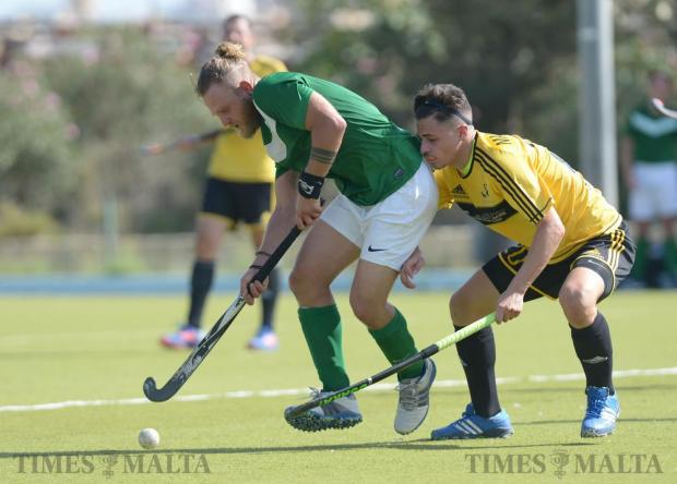 Two players compete for the ball during the Super Cup final between Poiatti Qormi and Floriana Young Starts at the Kordin National Hockey Centre in Corradino on October 9. Photo: Matthew Mirabelli