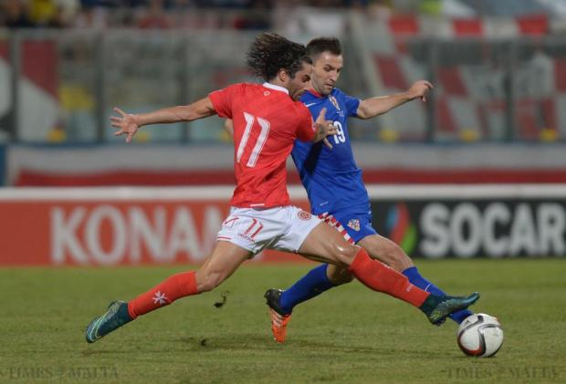 Malta's Rowen Muscat (left) tries to steal the ball from Croatia's Milan Badelj during their UEFA European Championship Qualifying match against Malta at the National Stadium in Ta'Qali on October 13. Photo: Matthew Mirabelli
