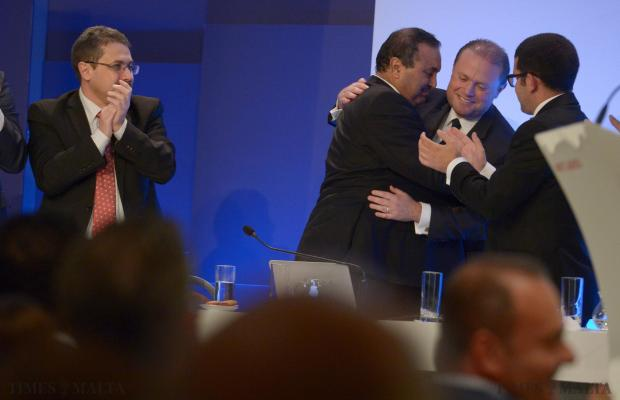 Labour deputy leader Toni Abela is embraced by Prime Minister Joseph Muscat before making his final speech to delegates at the headquarters in Hamrun on February 5. Photo: Matthew Mirabelli