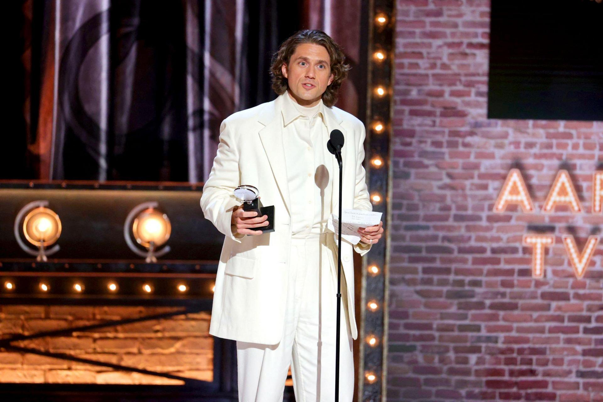 Aaron Tveit accepts the award for Best Performance by an Actor in a Leading Role in a Musical for 'Moulin Rouge! The Musical'.