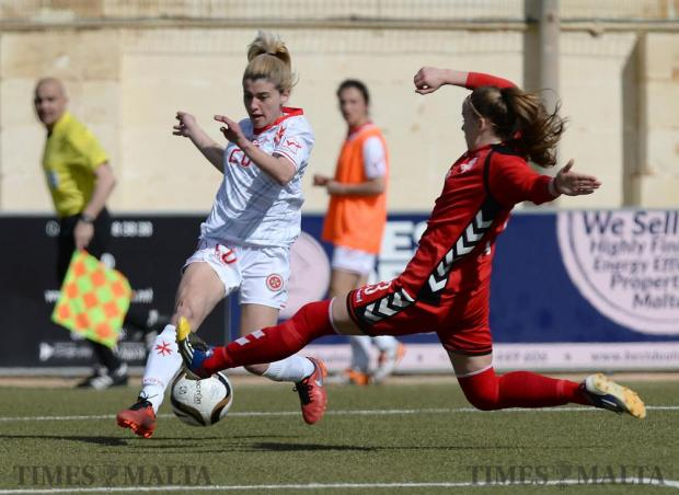 Malta winger Alishia Sultana (left) tries to make inroads in the Lithuanian defense during their friendly match at the Centenary Stadium in Ta'Qali on February 10. Photo: Matthew Mirabelli