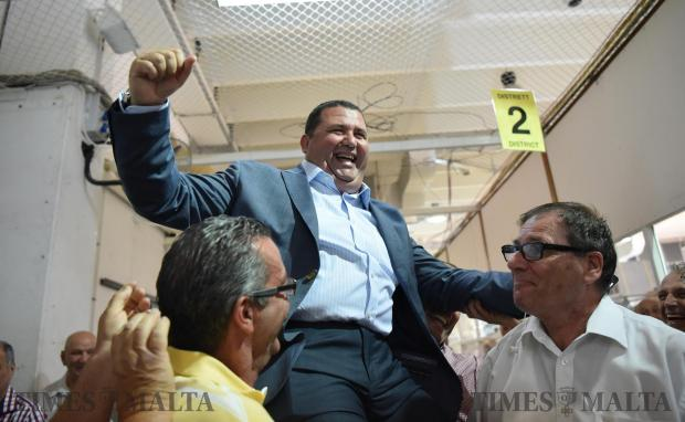 Labour Party candidate Glenn Bedingfield is lifted up by supporters moments after he was elected on the second district during the casual election held at the Naxxar counting hall on June 20. Photo: Mark Zammit Cordina