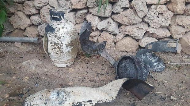 The remains of a gas cylinder which appears to have exploded.