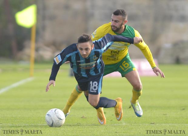 Going down... Sliema forward Aidan Friggieri (left) tumbles to the ground after being challenged by Matthew Gauci, of Żebbuġ Rangers at Hibernians Stadium in Paola on January 10. Photo: Matthew Mirabelli