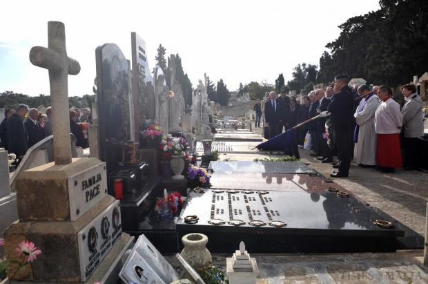 Veterans and their families remember the dead at the Royal Malta Artillery grave at the Addolorata cemetery on November 29. Photo: Chris Sant Fournier