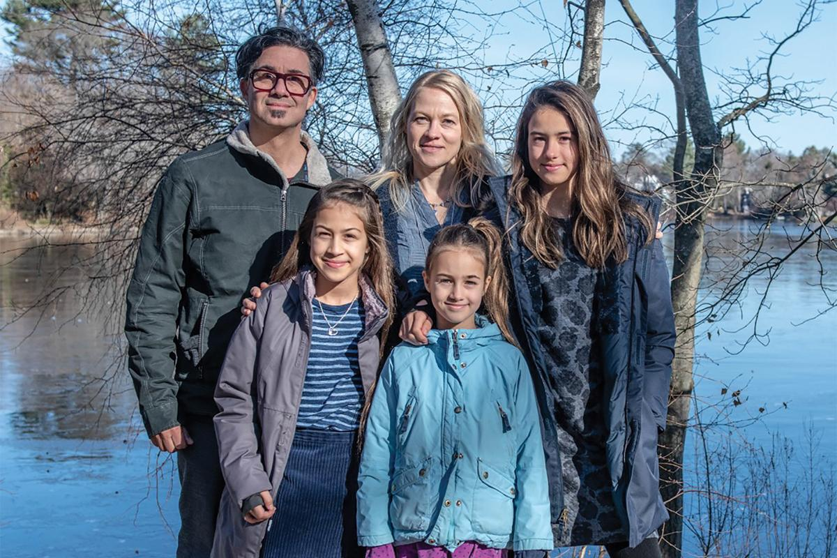 Derrick, his wife Nina and daughters Inka, Lumi and Oona near their home in Massachusetts.