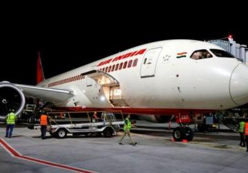 Flight attendant falls out of parked aircraft