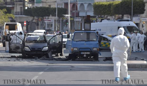 A forensics expert uses a drone at the scene after a car bomb that went off in Msida on February 20. Photo: Mark Zammit Cordina
