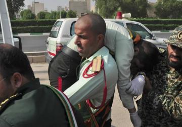 Gunmen kill 24, including 12 guards, in attack on Iran military parade