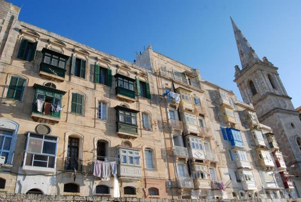 Laundry hangs outside balconies in Valletta on November 19. Photo: Mark Zammit Cordina