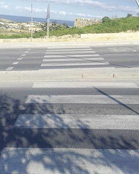 The pedestrian crossing at Naxxar Gap with part of the Victoria Lines fortifications built by the Knights of St John visible in the background.